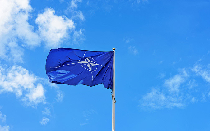 Flag Of Nato Waving In Wind